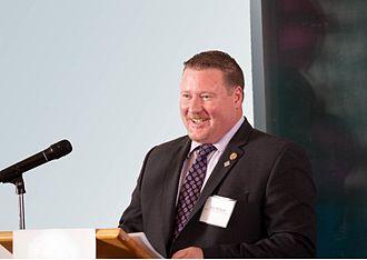 Rob Milligan (politician) - Image: Rob Milligan Podium Sm