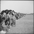 Rohwer Relocation Center, McGehee, Arkansas. A crowd of evacuees watching a football game between t . . . - NARA - 538920.tif