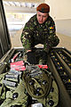 Romanian Land Forces Cpl. Romica Sirbi organizes a box of multiple integrated laser engagement system parts for inventory during a mission rehearsal exercise at the Joint Multinational Readiness Center 130305-A-ZD093-005.jpg