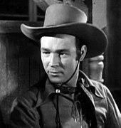 Roy Rogers dressed in cowboy gear.