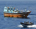 Royal Navy Seaboat Circling a Dhow in the Indian Ocean during Routine Checks MOD 45156379.jpg