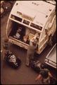 SANITATION WORKERS COLLECT GARBAGE ON 172ND STREET IN MANHATTAN - NARA - 549844.tif