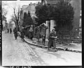 SC 196667 - A group of German snipers, taken during the fight for a road leading out of Belfort, France, is led through the streets of the city by members of the 1st French Armored Division. 22 November, 1944.jpg