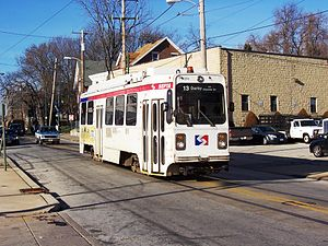 Trolley 9074 on the Route 13 line on Main Street in Darby, PA.