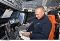 STS-127 Hurley looks over checklist.jpg