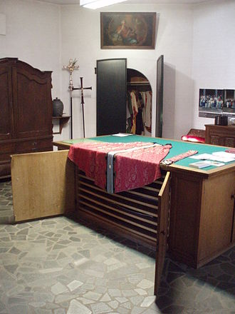 Sacristy - Sacristy with a sacristy credens (a cabinet with wide and very shallow drawers in which vestments and hangings are stored). A chasuble and stole are laid out on top of it, ready to be put on.