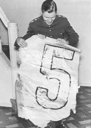 Jorma Sarvanto - Sarvanto holding a piece of a rudder from one of the downed aircraft.