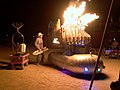 Satan's Calliope, a flaming pipe organ, played through the Royalex Probe (keytar) by Lucy Hosking (Lucyfer) (Burning Man 2006).jpg