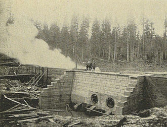 Seattle Public Utilities - Water supply intake and wing dam under construction, 1900.