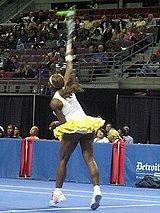 Williams delivering a serve in 2004.