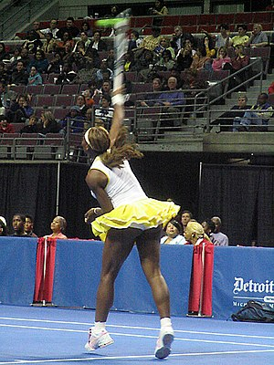 Serena Williams - Delivering a serve at an exhibition in November 2004.