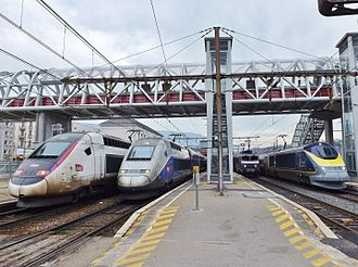 SNCF - 3 French TGVs (left) with 1 TER Commuter and new liveried Eurostar Class 373 (right) in Chambéry, France