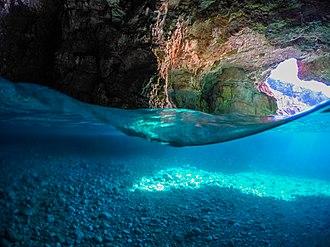 Karaburun-Sazan Marine Park - Shpella e Dafinës, caves appear mostly underwater.