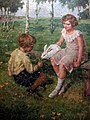 Simon Glücklich Kinder füttern einen Hasen.jpg