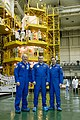 Soyuz TMA-20M crew in front of the scaffolding surrounding their spacecraft.jpg