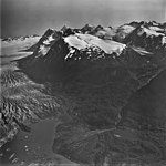 Spencer Glacier, terminus of valley glacier, hanging glaciers and mountain glaciers on the surrounding peaks, September 3, 1977 (GLACIERS 6872).jpg