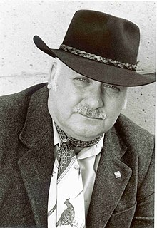 Photograph of Stanley Coren wearing Western-style hat and scarf