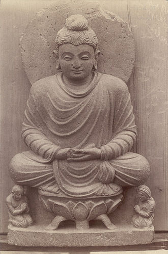 Swat District - An 1869 photo of a Buddha statue seated on a lotus throne in Swat Valley.