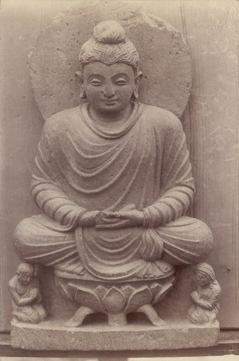 Statue of a Buddha seated on a lotus throne in Swat Valley