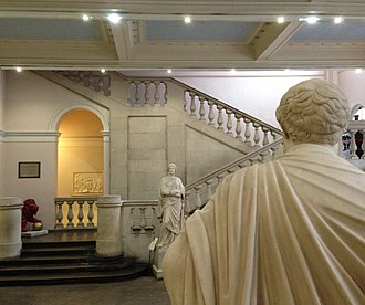 King's College London Faculty of Arts and Humanities - Greek marble statues at the main hall of King's Building: lyric poet Sappho (fronting) and dramatist Sophocles (back turned)