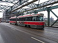 Streetcars on the Queen Street bridge over the Don River, 2014 12 03 (2) (15943770085).jpg