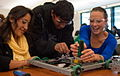 Students work on robots at Cañada College.jpg