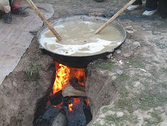 Kazan (cookware) - Sumalak being made in a kazan in a ground oven.