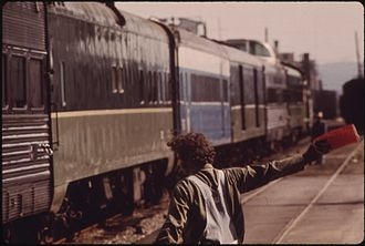 Amtrak Cascades - The Mount Rainier in 1974. Note the dome car and coaches still bearing pre-Burlington Northern liveries.