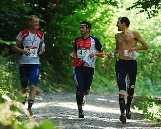 2009 World Orienteering Championships - Nordberg, Smola, and Gueorgiou finishing the race after aiding Johansson