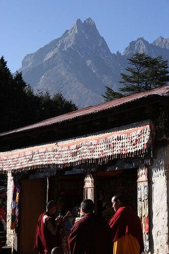 Mount Khumbila - Monks of Tengboche Monastery enjoying Tea during Mani Rimdu Festival with Mount Khumbila in the background