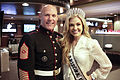 The 17th Sgt. Maj. of the Marine Corps, Micheal P. Barrett, left, poses for a photo with 2011 Miss Arizona USA Brittany Brannon, prior to the Semper Fidelis All-American Bowl at Chase Field in Phoenix, AZ 120103-M-OX530-947.jpg