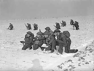 48th (South Midland) Division - An officer briefs his section leaders during an exercise in the snow by men of the 1/7th Battalion, Royal Warwickshire Regiment, between Douai and Orchies, France, 26 January 1940.