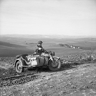 78th Infantry Division (United Kingdom) - Private Stephens of the 5th Battalion, Northamptonshire Regiment rides a captured German motorcycle combination, Tunisia, 14 January 1943.