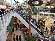 The Mall, an out-of-town shopping centre at Patchway, near Bristol, England. Escalators connect the upper and lower levels.