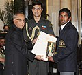 The President, Shri Pranab Mukherjee presenting the Rajiv Gandhi Khel Ratan Award for the year-2012 to Shri Yogeshwar Dutt for Wrestling, in a glittering ceremony, at Rashtrapati Bhavan, in New Delhi on August 29, 2012.jpg
