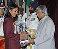 The President Dr. A.P.J. Abdul Kalam presenting the Arjuna Award -2005 to Ms. Aparna Popat for Badminton, at a glittering function in New Delhi on August 29, 2006.jpg