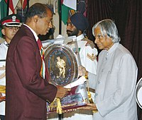 The President Dr. A.P.J. Abdul Kalam presenting the Dhyan Chand Award – 2006, to Shri Harish Chandra M. Birajdar for Wrestling, at a glittering function in New Delhi on August 29, 2006.jpg