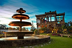 View of The Ruins of the Mariano Ledesma Lacson Mansion, Talisay City at dusk