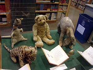 "Winnie-the-Pooh - Original Winnie-the-Pooh stuffed toys. Clockwise from bottom left: Tigger, Kanga, Edward Bear (""Winnie-the-Pooh""), Eeyore, and Piglet. Roo was lost long ago; the other characters were made up for the stories."