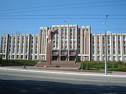 The Transnistrian parliament building in Tiraspol. In front is a statue of Lenin