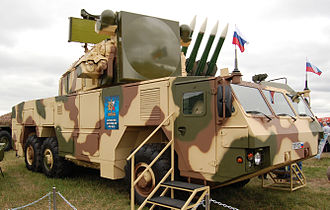 Tor M2E on MZKT-6922 vehicle features at the MAKS 2009 show (Buk missiles in the background) Tor M2E maks2009.jpg