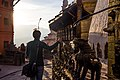 Tourist-rotating-prayer-wheels-at-swayambhunath-temple-kathmandu.jpg