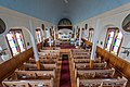 Toutes Aides Roman Catholic Church - pews from upper rear.jpg
