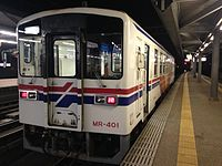 Train bounding for Tabira-Hiradoguchi Station before departure at Sasebo Station at night.JPG