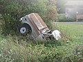 Truck partially buried in ground as art near Port Townsed, WA. (15260669571).jpg