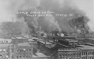 Tulsa race riot - Little Africa on Fire. Tulsa Race Riot, June 1, 1921 Apparently taken from the roof of the Hotel Tulsa on 3rd St. between Boston Ave. and Cincinnati Ave. The first row of buildings is along 2nd St. The smoke cloud on the left (Cincinnati Ave. and the Frisco Tracks) is identified in the Tulsa Tribune version of this photo as being where the fire started.