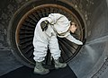 U.S. Air Force Staff Sgt. Jennifer Smith, a jet propulsion specialist with the 437th Maintenance Group, runs her hand along the inside of a C-17 Globemaster III aircraft engine to inspect for cracks, bumps 130626-F-LR006-003.jpg