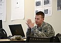 U.S. Army Capt. Caleb Emde, a member of the Oklahoma Army National Guard, reviews information in the Emergency Operations Center (EOC) in Norman, Okla., May 27, 2013 130527-Z-TK779-026.jpg