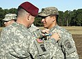 U.S. Army Col. Michael Fenzel, left, the commander of the 3rd Brigade Combat Team, 82nd Airborne Division pins an Expert Infantryman Badge (EIB) on a paratrooper during an awards ceremony at Pike Field, Fort 121108-A-CK226-006.jpg