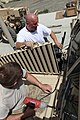U.S. Navy Construction Mechanic 1st Class William Cook, assigned to Construction Battalion Maintenance Unit 202, attached to the Khost Provincial Reconstruction Team, and Brian Coll, a force protection Cougar 120811-A-PO167-035.jpg